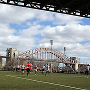 Action during the Binghamton Devils (red) V West Pontomac rugby match during the Four Leaf 15's Club Rugby Tournament at Randall's Island New York. The tournament included 70 teams in 6 divisions, organized by the New York City Village Lions RFC. Randall's Island, New York, USA. 23rd March. Photo Tim Clayton