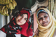 Port Said, Egypt - April 24, 2010: Portrait of two young Egyptian women at a fruit juice stand in Port Said.
