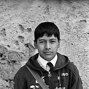 Rodrigo Hidalgo, 14, Student. Potosi. Bolivia..Sitting at 4,090M (13,420 Feet) above sea level the small mining community of Potosi, Bolivia is one of the highest cities in the world by elevation and sits ?sky high? in the hills of the land locked nation. Overlooking the city is the infamous mountain, Cerro Rico (rich mountain), a mountain conceived to be made of silver ore. It was the major supplier of silver for the spanish empire and has been mined since 1546, according to records 45,000 tons of pure silver were mined from Cerro Rico between 1556 and 1783, 9000 tons of which went to the Spanish Monarchy. The mountain produced fabulous wealth and became one of the largest and wealthiest cities in Latin America. The Extraordinary riches of Potosi were featured in Maguel de Cervantes famous novel Don Quixote. One theory holds that the mint mark of Potosi, the letters PTSI superimposed on one another is the origin of the dollar sign. Today mainly zinc, lead, tin and small quantities of silver are extracted from the mine by over 100 co-operatives and private mining companies who still mine the mountain in poor working conditions, children are still used in the mines and the lack of protective equipment and constant inhalation of dust means miners have a short life expectancy with many contracting silicosis and dying around 40 years of age. UNESCO designated the historic city a World Heritage site in 1987. Most of Potosí's colonial churches have been restored, and tourism has increased. Potosi, Bolivia. 16th September 2011. Photo Tim Clayton