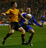 Photo: Steve Bond/Sportsbeat Images.<br />Wolverhampton Wanderers v Leicester City. Coca Cola Championship. 22/12/2007. Iain Hume (R) tries to lift the ball over Kevin Foley (L)