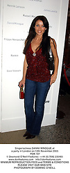 Singer/actress DANNII MINOGUE at a party in London on 12th November 2003.<br /> POK 107