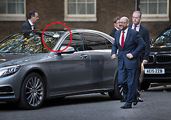 © Licensed to London News Pictures. 22/09/2016. London, UK. President of the European Parliament, Martin Schulz arrives in Downing Street to meet with Prime Minister Theresa May in a private hire taxi. The S350 series Mercedes carries a private hire vehicle sticker in it's windscreen (ringed) .  Photo credit: Peter Macdiarmid/LNP