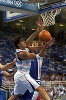 29/08/04 - ATHENS  - GREECE -  - BASKETBALL SEMIFINAL MATCH   - Indoor Olympic Stadium - <br />ARGENTINA win over ITALY and win the GOLD MEDAL<br />Argentine celebration after win the match.<br />Here Argentine ALEJANDRO MONTECCHIA and italy N*6 GALANDA GIACOMO.<br />© Gabriel Piko / Argenpress.com / Piko-Press