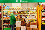 Staff members work at a Metro supermarket in Shanghai, China on 20 May 2010. Metro Group is the third largest retailing company in the world and currently has over forty store in China.