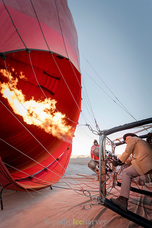 Two men preparing hot air balloon to start his adventure, Atacama Desert, Chile