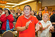 Nov. 11, 2009 -- PHOENIX, AZ: Union members cheer during a meeting of the UFCW at the Airport Marriott Hotel in Phoenix. The United Food and Commercial Workers Union (UFCW) Local 99 has about 25,000 members in Arizona: 15,000 in Fry's grocery stores and Fry's Marketplace, 9,500 in Safeway stores and 400 in Smith's grocery stores. The union voted down the last proposal from the stores and has announced plans to go on strike at 6PM on Friday, Nov. 13. The meeting Wednesday is the last one before the strike.   Photo by Jack Kurtz
