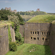 Drop Redoubt built in 1808 during the Napoleonic wars. Dover Castle and St. Mary in Castro church behind.
