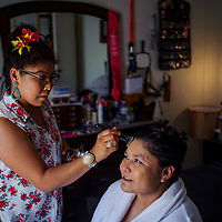 Dana Nez, right, has her makeup done by friend Goldie Tom before Nez's wedding in Tohatchi Saturday.