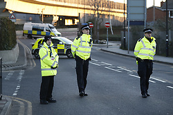 © Licensed to London News Pictures. 12/02/2018. London, UK. Police man a roadblock at City Airport after a World War II era bomb was found in The River Thames during routine work on nearby King V Dock. Police have evacuated nearby residents, closed the airport and set up a 214-metre exclusion zone. Photo credit: Peter Macdiarmid/LNP
