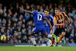 Jake Livermore of Hull City shoots past Mikel John Obi of Chelsea - Photo mandatory by-line: Rogan Thomson/JMP - 07966 386802 - 13/12/2014 - SPORT - FOOTBALL - London, England - Stamford Bridge - Chelsea v Hull City - Barclays Premier League.