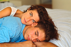 Couple resting on a bed together