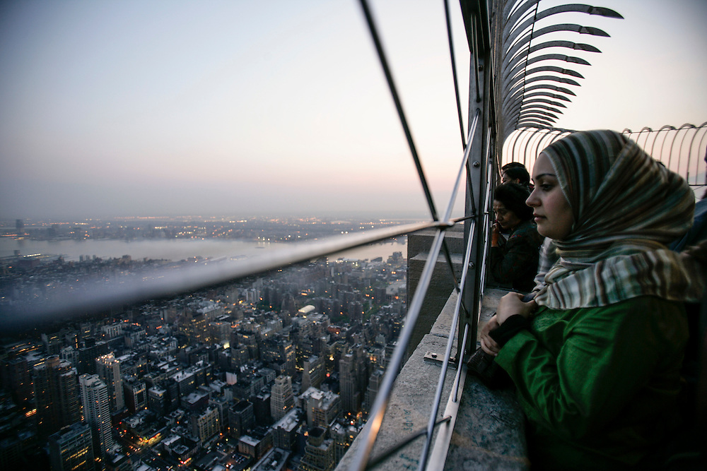 A visitor sees the view of Manhattan buildings  from the Empire State Building viewing deck.
