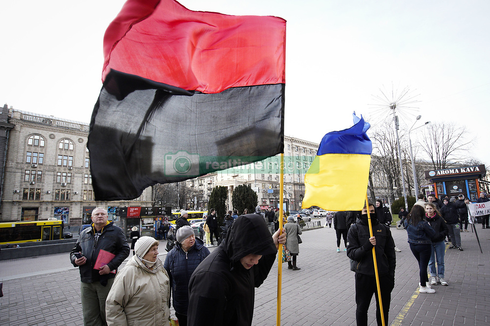 March 29, 2019 - Kiev, Ukraine - Youths are seen holding a Ukrainian flag and a Ukrainian Insurgent Army flag in central Kyiv, Ukraine on March 29, 2019. The red and black flag is considered a fascist symbol in Russia. (Credit Image: © Jaap Arriens/NurPhoto via ZUMA Press)