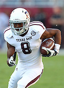TUSCALOOSA, AL - NOVEMBER 10:  Wide receiver Thomas Johnson #8 of the Texas A&M Aggies runs after a catch during the game against the Alabama Crimson Tide at Bryant-Denny Stadium on November 10, 2012 in Tuscaloosa, Alabama.  (Photo by Mike Zarrilli/Getty Images)
