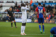 Modou Barrow of Swansea City misses a chance on goal during the Premier League match between Swansea City and Crystal Palace at the Liberty Stadium, Swansea, Wales on 26 November 2016. Photo by Andrew Lewis.