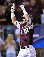 Texas A&M's Jonathan Moroney (40) reacts as he crosses home plate after hitting a home run against TCU during the sixth inning of a NCAA college baseball Super Regional tournament game, Saturday, June 11, 2016, in College Station, Texas. (AP Photo/Sam Craft)