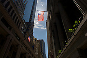 Tall, wide view of banking and financial institutions on Wall Street, Lower Manhattan, New York City. This famous street symbolises the US economy. Wall Street is a 0.7 miles (1.1 km), eight-block-long, street running west to east from Broadway to South Street on the East River in Lower Manhattan in the financial district of New York City. Over time, the term has become a metonym for the financial markets of the United States as a whole, the American financial sector or signifying New York-based financial interests.