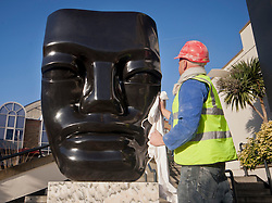© licensed to London News Pictures. London, UK 15/01/12. Master stone-carver Paul Vanstone positions his gaint scuplture outside Business Design Centre in London for the 24th London Art Fair, the UK's largest fair for Modern British and contemporary art. Photo credit: Tolga Akmen/LNP