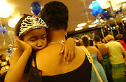 A young girl is seen resting on her mother's shoulder during the Pediatrics Prom at Memorial Sloan-Kettering Cancer Center in Manhattan, NY. 6/7/2005 Photo by Jennifer S. Altman
