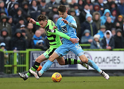 Forest Green Rovers Dayle Grubb and Coventry City's Tom Bayliss battle for possession