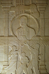 A marble mural depicting Saddam Hussein is seen inside the now partially destroyed Salam Palace in Baghdad, Iraq, Sept. 29, 2003. According to Iraqi architect Mowfaq Al-Tai, the Salam Palace is most representative of the design and architecture used in the hundreds of palaces built for Saddam Hussein. Al-Tai was one the the engineers involved in the construction and quality control of the Hussein palaces.