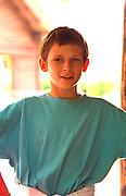 Boy age 12 cracking a smile. Ancient Slavic Settlement Biskupin Poland