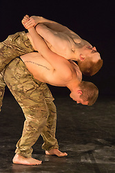 "© Licensed to London News Pictures. 07/05/2015. London, England. Male Duet performed by Duncan Anderson and Oliver Russell. The Rosie Kay Dance Company perform ""5 Soldiers: The Body is the Frontline"" at The Rifles Officers' Club in Mayfair, London from 7 to 9 May 2015 before continuing a UK tour. 5 Soldiers gives an intimate view of the training that provides soldiers for combat and warfare and how the experience affects those that put their life on the line. Dancers: Duncan Anderson, Shelley Eva Haden, Chester Hayes, Sean Marcs and Oliver Russell. Choreographed and directed by Rosie Kay.  Photo credit: Bettina Strenske/LNP"
