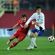 Turkey's Emre BELOZOGLU (L) and South Korean's Lee Yong-RAE (R) during their International friendly soccer match Turkey between South Korean at the Avni Aker stadium in Trabzon, Turkey on Wednesday 09 February 2011. Photo by TURKPIX