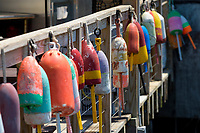 Lobster trap bouys are hung as decortion on a railing in Port Clyde, Maine.
