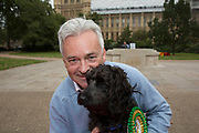 London, UK. Thursday 10th October 2013. The winner Alan Duncan MP and Noodle, a Cocker Spaniel / Poodle cross. MPs and their dogs competing in the Westminster Dog of the Year competition celebrates the unique bond between man and dog - and aims to promote responsible dog ownership.