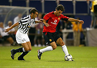 Photo Aidan Ellis.<br />Manchester United v juventus (Champions World Match at New York Giants Stadium East Rutherford).31/07/03.<br />United's Ruud Van Nistelerooy is challenged by Juve's Gianluca Pessotto