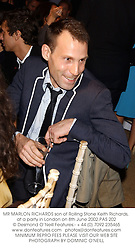 MR MARLON RICHARDS son of Rolling Stone Keith Richards, at a party in London on 8th June 2002.PAS 202