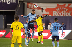 November 5, 2017 - Bronx, New York, U.S - New York City FC midfielder YANGEL HERRERA (30) heads the ball over Columbus Crew midfielder MOHAMMED ABU (8) during leg 2 of the Eastern Conference Semifinal at Yankee Stadium, Bronx, NY.  NYCFC defeats Columbus Crew 2-0.  Columbus wins 4-3 on aggregate. (Credit Image: © Mark Smith via ZUMA Wire)