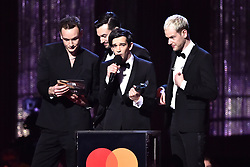 The 1975 with the award for Best British Album on stage at the Brit Awards 2019 at the O2 Arena, London. Photo credit should read: Matt Crossick/EMPICS Entertainment. EDITORIAL USE ONLY