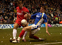 Photo: Daniel Hambury.<br />Portsmouth v Liverpool. The FA Cup. 29/01/2006.<br />Portsmouth's Gregory Vignal and Liverpool's Steven Gerrard battle for the ball.