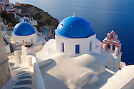 Oia, ( Ia ) Santorini - Blue domed Byzantine Orthodox churches, - Greek Cyclades islands .<br /> <br /> If you prefer to buy from our ALAMY PHOTO LIBRARY  Collection visit : https://www.alamy.com/portfolio/paul-williams-funkystock/santorini-greece.html<br /> <br /> Visit our PHOTO COLLECTIONS OF GREECE for more photos to download or buy as wall art prints https://funkystock.photoshelter.com/gallery-collection/Pictures-Images-of-Greece-Photos-of-Greek-Historic-Landmark-Sites/C0000w6e8OkknEb8
