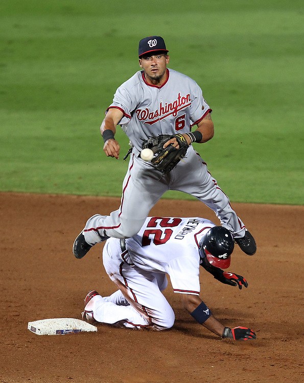ATLANTA, GA - AUGUST 30:  Shortstop Ian Desmond #6 of the Washington Nationals turns a double play while right fielder Jason Heyward #22 of the Atlanta Braves tries to take him out during the game at Turner Field on August 30, 2011 in Atlanta, Georgia.  (Photo by Mike Zarrilli/Getty Images)