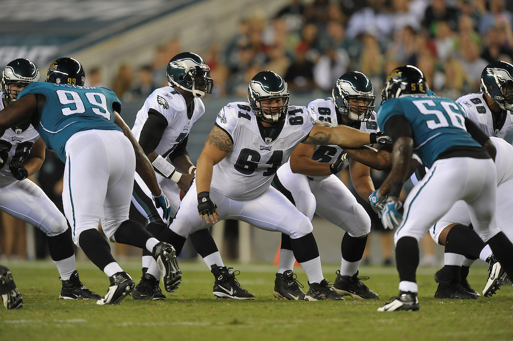 PHILADELPHIA - AUGUST 13: Center A.Q. Shipley #61 of the Philadelphia Eagles blocks during the game against the Jacksonville Jaguars on August 13, 2010 at Lincoln Financial Field in Philadelphia, Pennsylvania. The Eagles won 28-27. (Photo by Drew Hallowell/Getty Images)  *** Local Caption *** A.Q. Shipley
