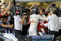 Rennen des Grand Prix von Abu Dhabi auf dem Yas Marina Circuit / 271116<br /> <br /> ***Abu Dhabi Formula One Grand Prix on November 27th, 2016 in Abu Dhabi, United Arab Emirates - Racing Day *** <br /> <br /> Nico Rosberg (GER) Mercedes AMG F1  and Sebastian Vettel (GER) Scuderia Ferrari <br /> 27.11.2016. Formula 1 World Championship, Rd 21, Abu Dhabi Grand Prix, Yas Marina Circuit, Abu Dhabi, Race Day.<br /> - www.xpbimages.com, EMail: requests@xpbimages.com - copy of publication required for printed pictures. Every used picture is fee-liable. © Copyright: Charniaux / XPB Images