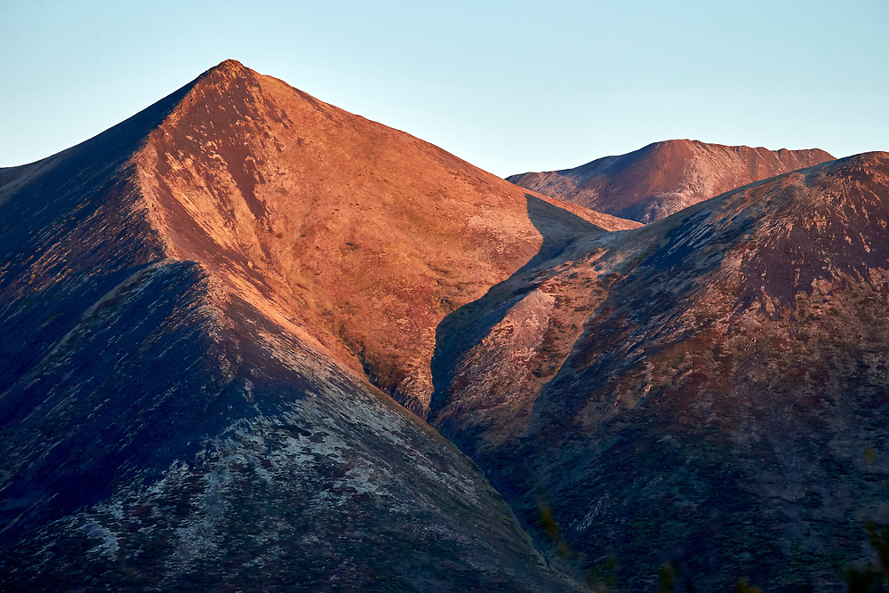 Morning sun lights up this mountain range, as seen from the Goldenside trail head, Tombstone Territorial Park, Yukon.