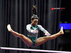 Aug 9, 2019; Kansas City, MO, USA; Simone Biles performs on the uneven bars during the 2019 U.S. Gymnastics Championships at Sprint Center. Mandatory Credit: Denny Medley-USA TODAY Sports