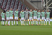 Celtic players line up for a minutes silence during the Scottish Premiership match between Motherwell and Celtic at Fir Park, Motherwell, Scotland on 8 November 2020.