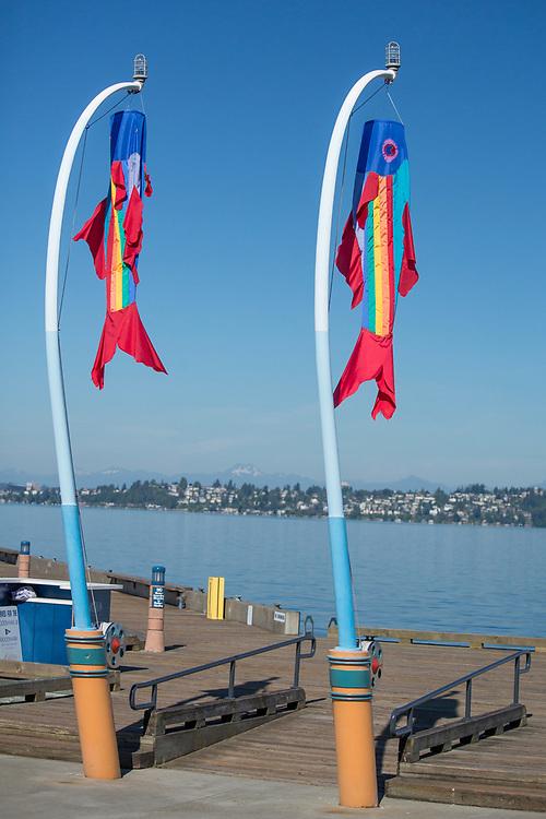 North America, United States, Washington, Kirkland, fish flags and dock on Lake Washington