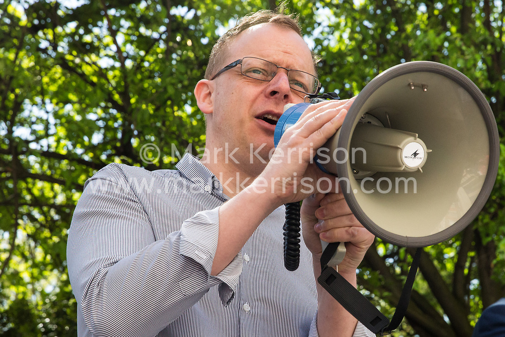 London, UK. 4th May, 2018. Nick Dearden of Global Justice Now addresses members of the National Education Union (NEU) demonstrating outside the AGM of multinational assessment service Pearson in protest against investment by the corporation in 'low-fee' private schools provider Bridge. Bridge, one of the world's largest education-for-profit companies, aims to extend its influence throughout Africa and Asia.