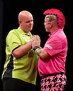 Michael van Gerwen (left) during his final match against Peter Wright (right) in the Betway Premier League Darts at the Brighton Centre in Brighton, East Sussex. PRESS ASSOCIATION Photo. Picture date: Thursday 15th May, 2014. Photo credit should read: Chris Ison/PA Wire.