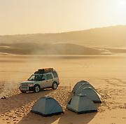 A desert campsite at sunrise, Sahara Desert, Libya