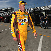 NASCAR Sprint Cup driver Kyle Busch walks in the garage area, during a NASCAR Daytona 500 practice session at Daytona International Speedway on Wednesday, February 20, 2013 in Daytona Beach, Florida.  (AP Photo/Alex Menendez)