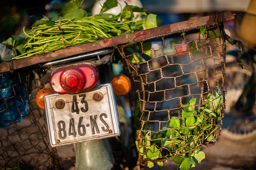 Motorbike carrying vegetables in baskets (Vietnam)