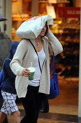 © Licensed to London News Pictures. 13/08/2015<br /> Wet weather TODAY (13.08.2015)<br /> Shoppers at Bromley High Street,Bromley,Greater London getting wet this afternoon as a severe weather warning for rain and thunderstorms in London and south east England has been issued by the Met Office .<br /> <br /> <br /> (Byline:Grant Falvey/LNP)