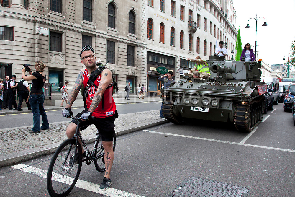 Tank passing the South African High Commission, Trafalgar Square. Campaigners and supporters from Oxfam and Amnesty International, as part of the Control Arms coalition, drive an Abbot gun tank around central London to highlight the need for a global Arms Trade Treaty (ATT) to be agreed during a United Nations conference next month (July 2012). London, England, UK. 27th June 2012.